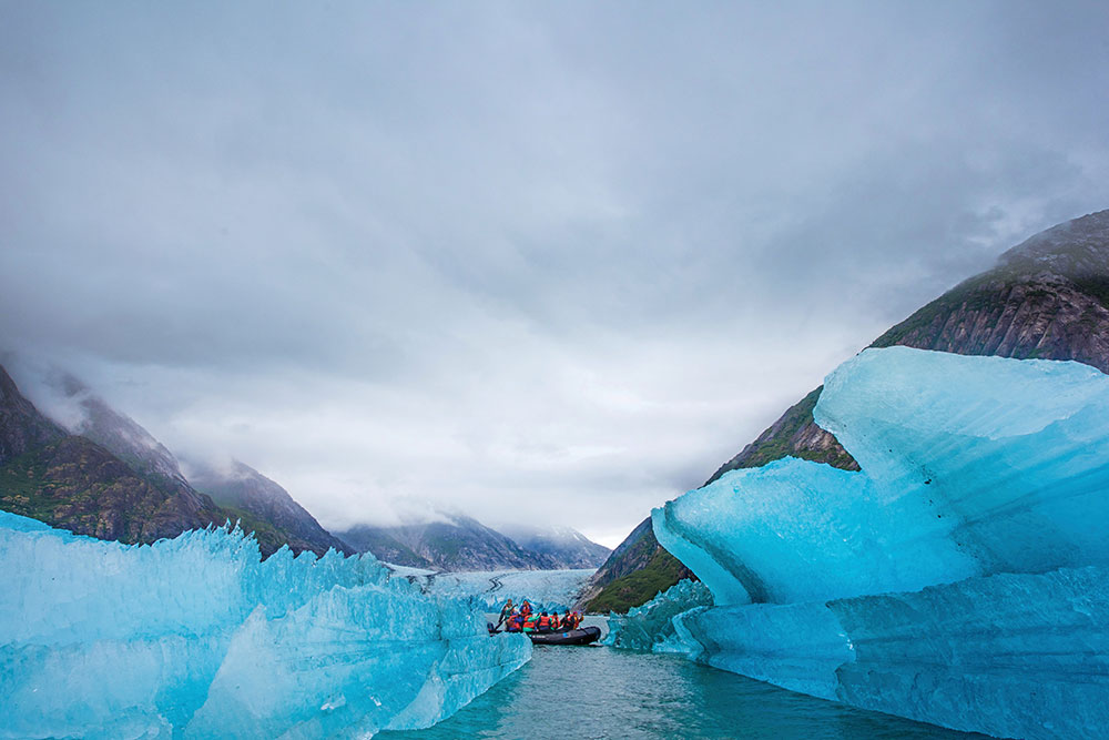 Riding Zodiac through glaciers in Alaska