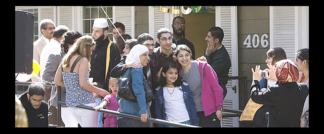Welcome to the neighborhood: Muslim community and friends celebrate dedication of center. Les Todd