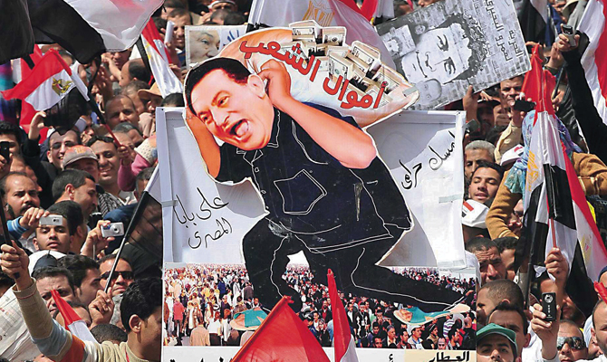 Revolution, continued: Two months after Hosni Mubarak was forced out of office, tens of thousands of Egyptians crowded Cairo's Tahrir Square to demand his prosecution. Associated Press
