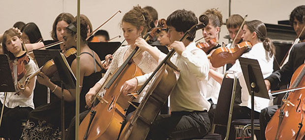 Amateur professionals: members of the DUSS Youth Symphony Orchestra, overleaf; Kitchen, conducting center, demands that her students approach music as a dedicated pursuit, not a recreational activity