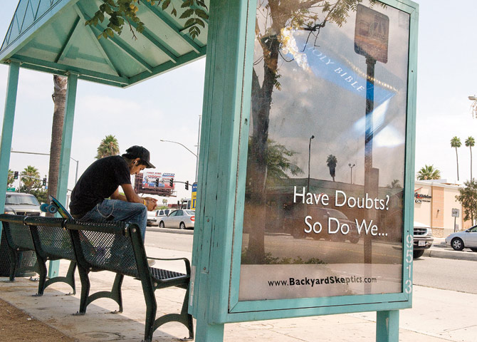 Signs of the times: Bus-shelter ads in Orange County, California, take on a religiously skeptical attitude. Ken Steinhardt/ZUMA Press/Corbis