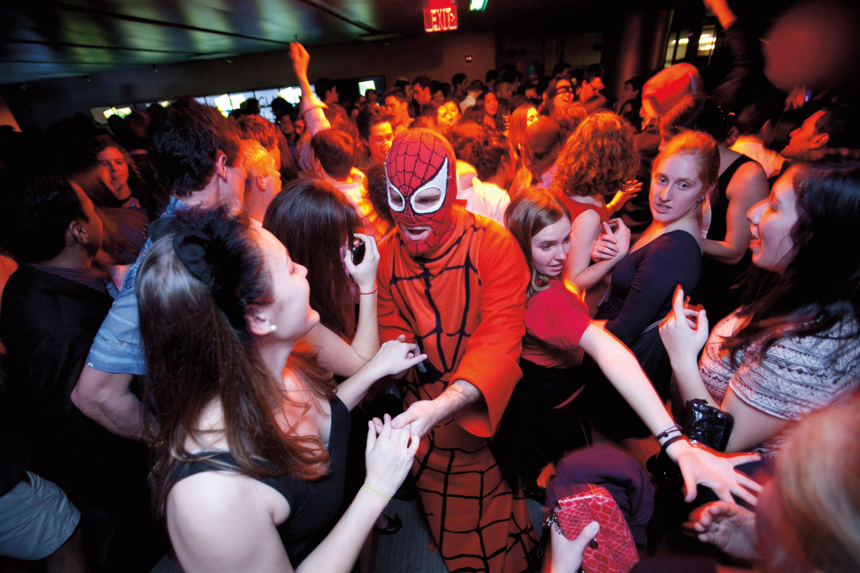 Spidey senses: Masked avengers and caped crusaders overtake Perkins Library for its annual party. [Credit: Megan Morr]