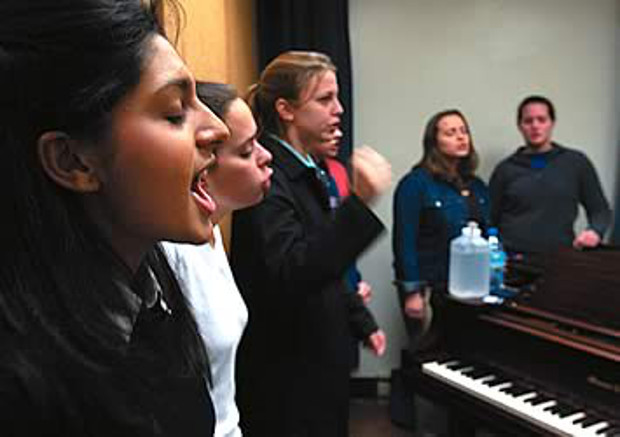 Singing out: Sonali Hippalgaonkar, left, rehearses with a cappella group Dèjà Blue. Jon Gardiner.