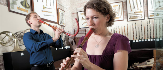 Sharp pitch: Music department graduate students Karen Cook and Stephen Pysnik A.M. '10 play crumhorns from the instruments collection. [Credit: Les Todd]