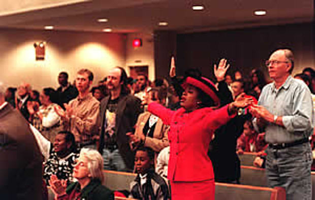Praise and thanksgiving: Members of the Assembly of God Tabernacle in Decatur, Georgia, worship together