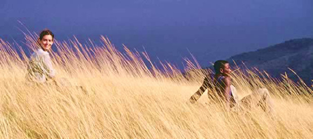 Study break: Lonsdorf, left, and colleague amid savanna grasses in Tanzania. Ian Gilby.
