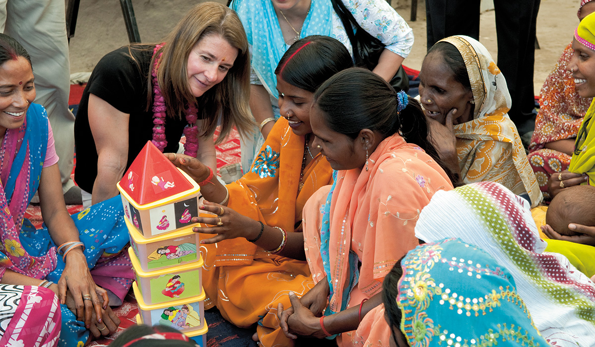 Building futures: Gates and participants at a Sure Start Project initiative to promote maternal and newborn health in India's Kathghara Village. © Bill & Melinda gates Foundation/Barbara Kinney.