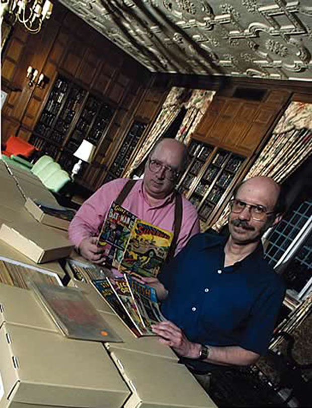 Phenomenal fans: brothers Terry, left, and Edwin Murray with some of their cache of comics Photo: Jim Wallace