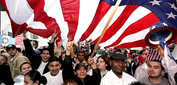 Rally round the flag: demonstrators in New York on April 10 protest House immigration bill. © Andrew Gombert /epa/Corbis