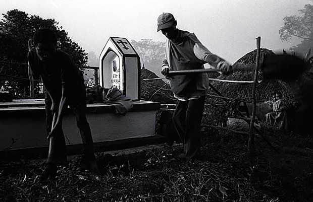 Makeshift work: Cemetery inhabitants step in for gravediggers. Peter Lemieux
