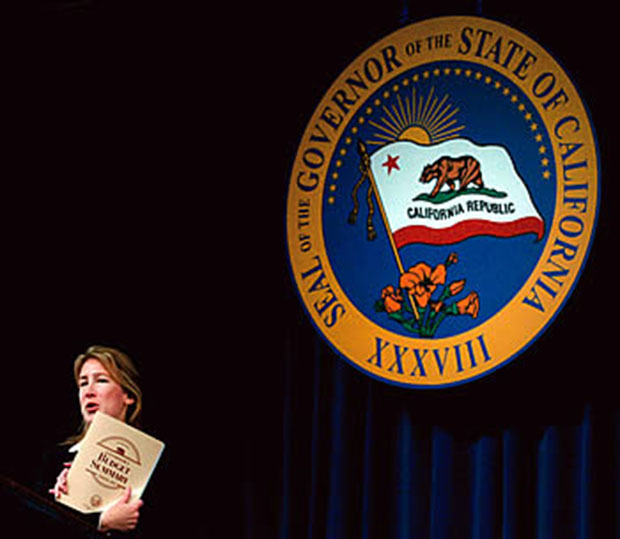 Taking account: Arduin answers questions after California Governor Arnold Schwarzenegger announces his $99 billion state budget for 2004-2005. © Ken James/Corbis