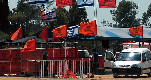 Signs of protest: orange settler flags amid Israeli flags. Courtesy of Sroussi family.