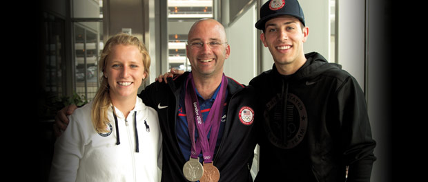Showing medal: Nick McCrory and Abby Johnston, with coach Drew Johansen, returning from London [Credit: Jon Gardiner]