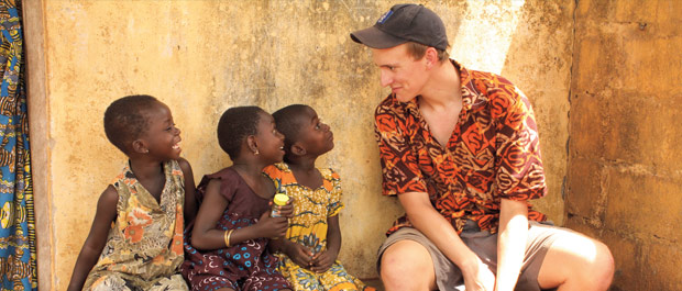 Don't blink: Ben Ramsey '15 has a staring contest with three girls in Kuwdé, a small village in northern Togo. Credit: Maria Romano '14.