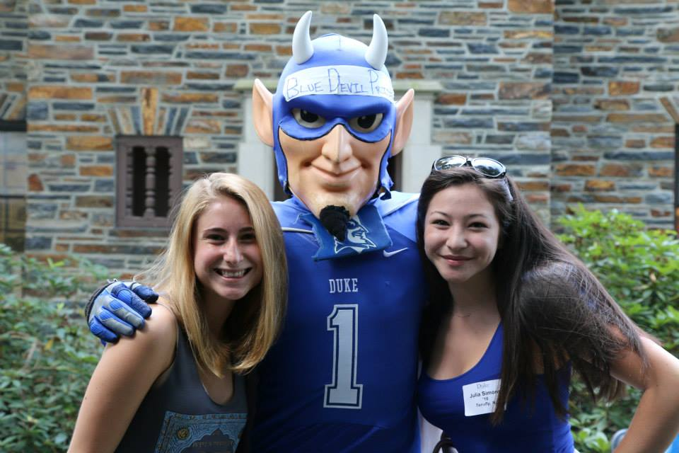 duke blue devil posing with two duke students